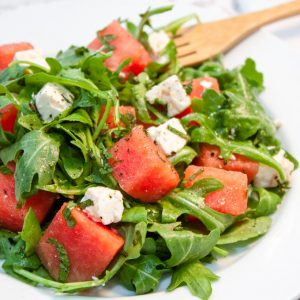 watermelon mixed with feta and arugula in bowl summer recipe