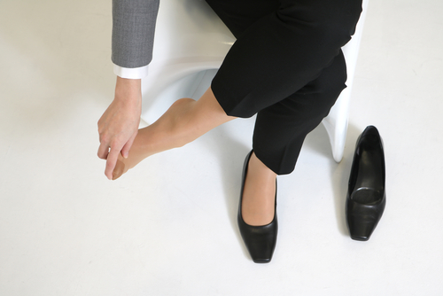 woman with pain on top of foot